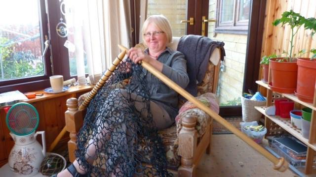 Woman Knits Lace Fence For Her Garden With Giant Needles